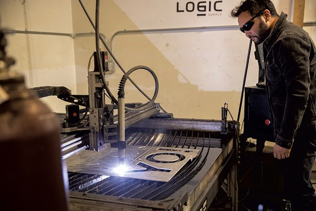 Elliott Katz working with the plasma cutter - JAMES BUCK