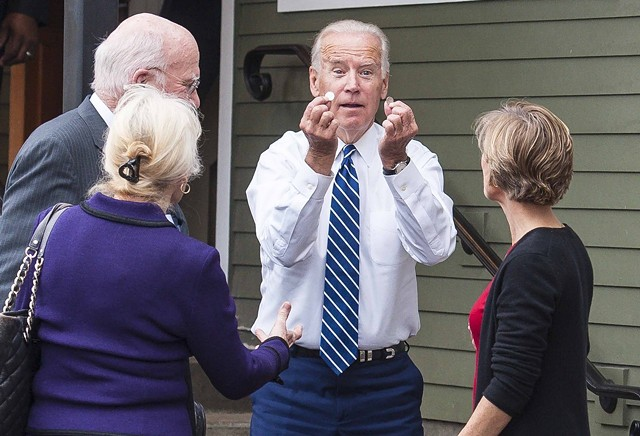 Then-vice president Joe Biden holding up coins he found outside Penny Cluse Café in October 2016 - POOL: GLENN RUSSELL/BURLINGTON FREE PRESS