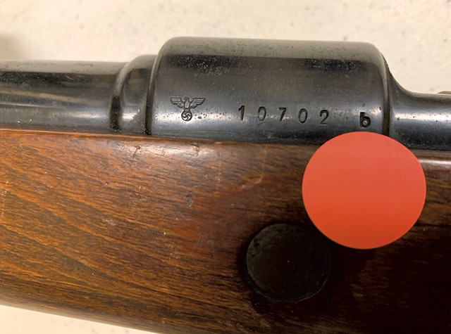 The Nazi Reichsadler emblem on a rifle that the state is selling - PAUL HEINTZ