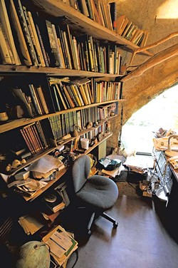 The main living room and loft , lit by rounded windows, contain mementos and artwork from Chappelle's travels. - JEB WALLACE-BRODEUR