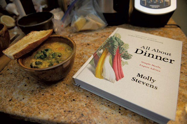 Vegetable-and-lentil soup alongside Molly Stevens' cookbook All About Dinner - DARIA BISHOP