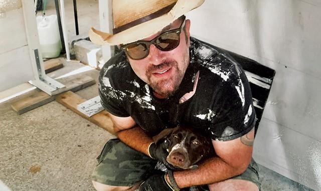 Jonnie Davis and his dog, Chili, at the Rutland Farmers Market - COURTESY PHOTO