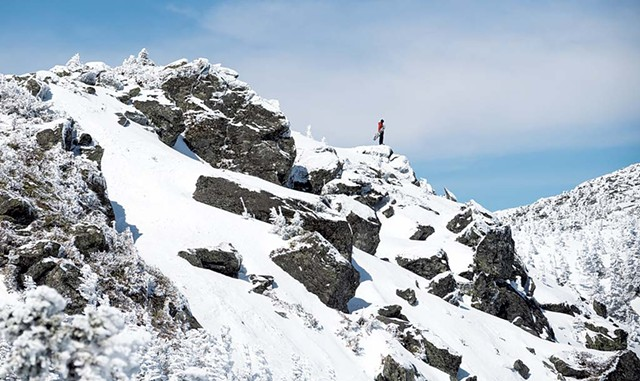 A snowboarder on the ridgeline of Mount Mansfield - NATHANAEL ASARO