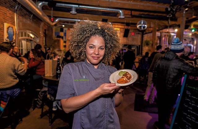 Maria Lara-Bregatta with a pollo empanada - GLENN RUSSELL