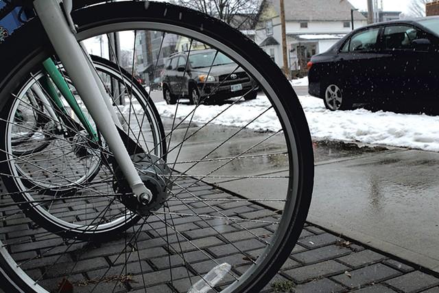 Parked bikes on North Winooski Avenue - COURTNEY LAMDIN