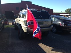 The Confederate flag flies Wednesday from a car at the BPW employee lot. - MOLLY WALSH
