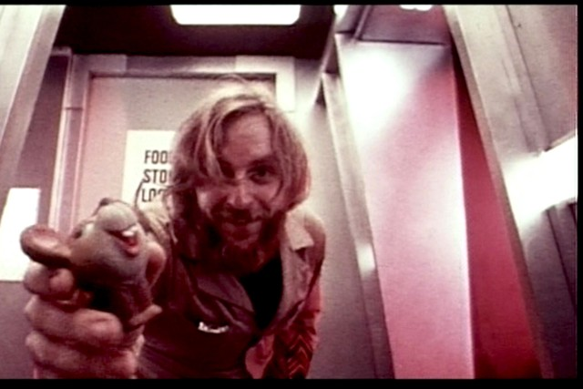 Pinback lures the alien with a toy mousie. - BRYANSTON PICTURES / JACK H. HARRIS ENTERPRISES / UNIVERSITY OF SOUTHERN CALIFORNIA