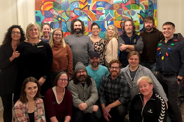 Top row from left to right; Paula Routly, Robyn Birgisson, Kaitlin Montgomery, Corey Grenier, Colby Roberts, Eva Sollberger, Michelle Brown,  Ken Picard, Paul Heintz and Don Eggert. - Bottom row from left to right; Carolyn Fox, Cathy Resmer, John James, Matt Weiner, Dan Bolles, Michael Bradshaw and Diane Sullivan. - Not present: Pamela Polston