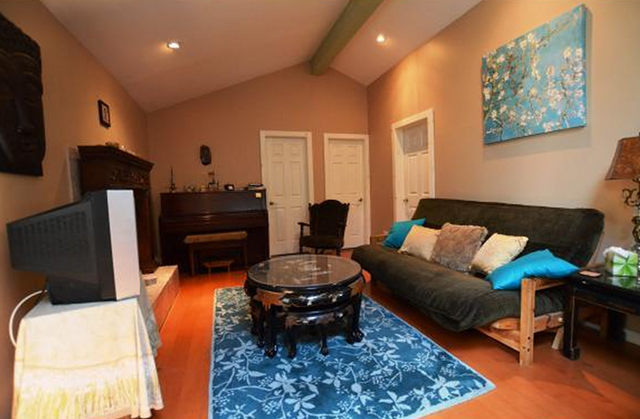 """Living room of the Shelburne home. """"We really grew accustomed to the [fireplace] in our apartment,"""" says Ashley, so having one in the new home is """"a nice bonus."""" - COURTESY OF TRULIA.COM"""
