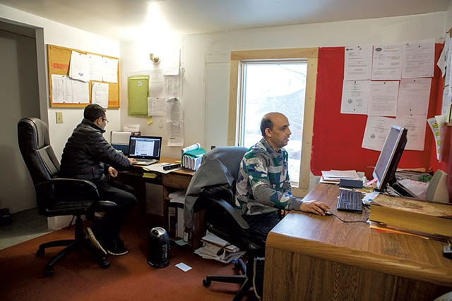 Bhuwan Sharma (left) and Chandra Pokhrel at their office - LUKE AWTRY