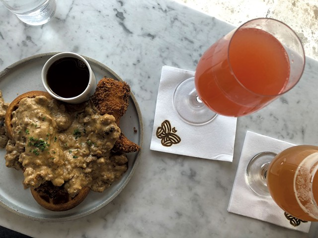 Half order of chicken and waffles at Monarch & the Milkweed, with brunch beverages - JORDAN BARRY
