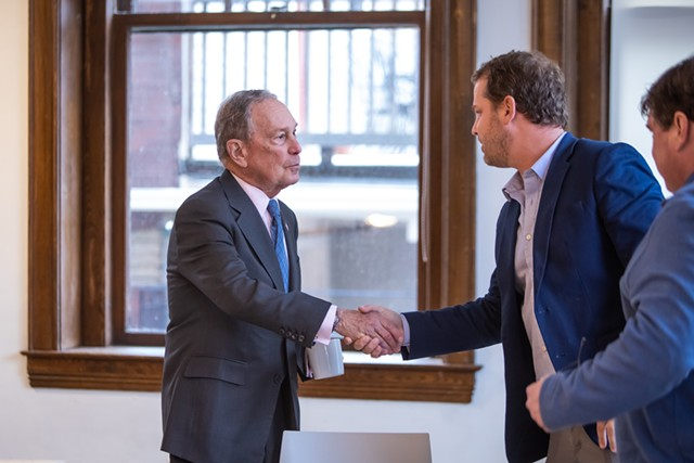 Michael Bloomberg, left, greets Rep. Sam Young at Kestrel Coffee Roasters in Burlington - LUKE AWTRY