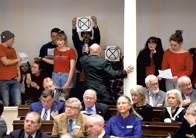 Extinction Rebellion activists during Gov. Phil Scott's State of the State address Montpelier - FILE: JEB WALLACE-BRODEUR