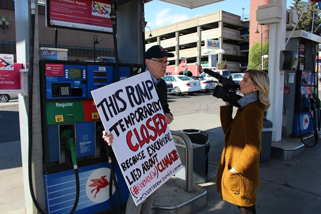 Bill McKibben protests at Handy's Mobil. - PAUL HEINTZ