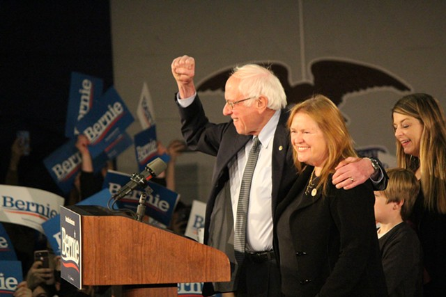 Sen. Bernie Sanders (I-Vt.) and Jane O'Meara Sanders at a campaign watch party in Des Moines, Iowa, on Monday night - PAUL HEINTZ