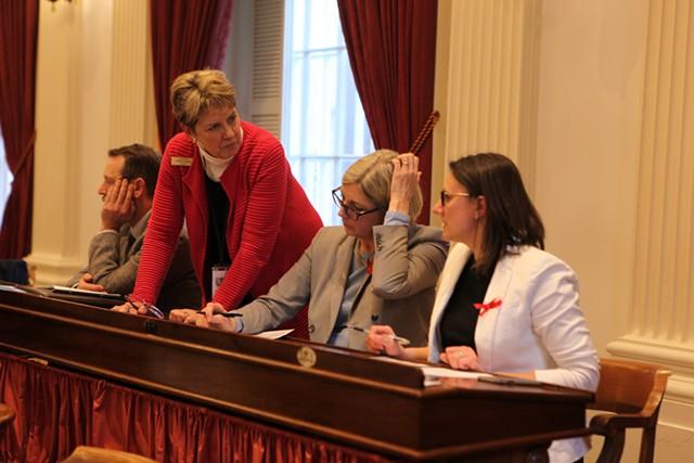 Democratic legislators conferring during Wednesday's failed override vote - KEVIN MCCALLUM