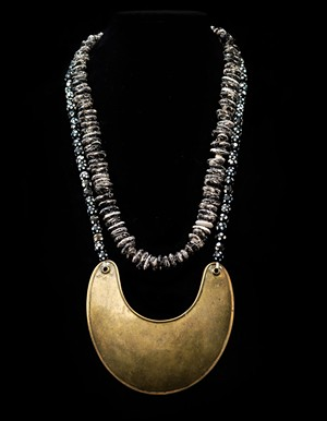 Original 1700s Hudson Bay Company gorgett and skunk bean necklace. These were given by the French to leaders during the French and Indian War, as a way for French troops to recognize status within a tribe. The French beads represented skunk beans that were worn by warriors in case they needed to make a soup in a hurry. - COURTESTY OF DIANE STEVENS
