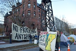Protesters on State Street in Montpelier in front of the Department of Public Service - TERRI HALLENBECK