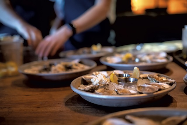 Preparing oysters at Hen of the Wood - LUKE AWTRY