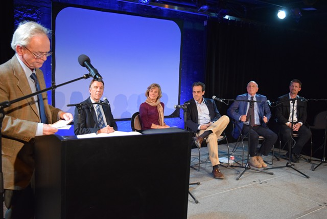 Moderator Mark Johnson speaks at a forum Monday night with five candidates for governor. From left: Republican Phil Scott, Democrat Sue Minter, Democrat Matt Dunne, Republican Bruce Lisman and Democrat Shap Smith. - TERRI HALLENBECK