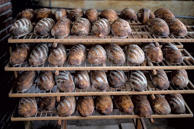Freshly baked sourdough bâtards - GLENN RUSSELL