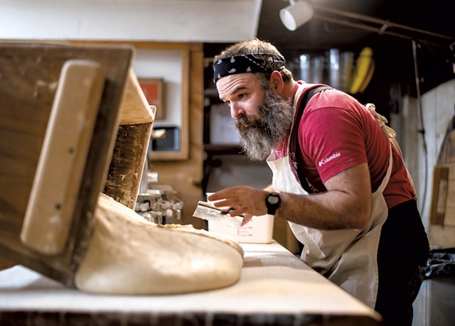 Trent Cooper preparing to portion and shape sourdough bread into bâtards - GLENN RUSSELL
