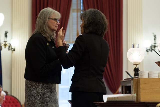 Rep. Patty McCoy and Speaker Mitzi Johnson on the House floor Friday - COLIN FLANDERS