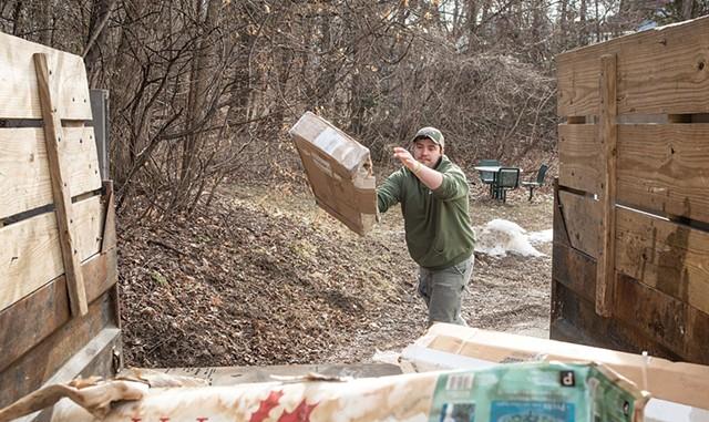 Kyler Leduc loading a truck for Grunts Move Junk in Burlington - LUKE AWTRY