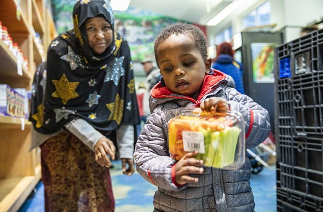 Nuna Ahmed and her grandson Mukhatar Kassim shop earlier this year at the Feeding Chittenden food pantry in Burlington. - COURTESY OF JUDE DOMSKI