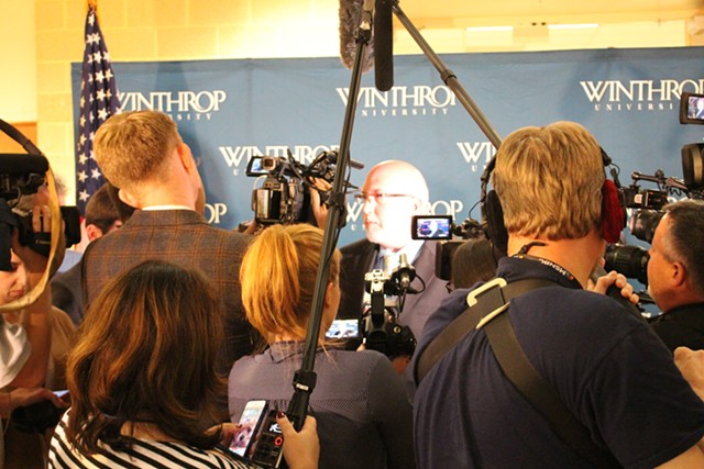 Sanders campaign manager Jeff Weaver, center, addresses reporters in the spin room after the forum - PAUL HEINTZ