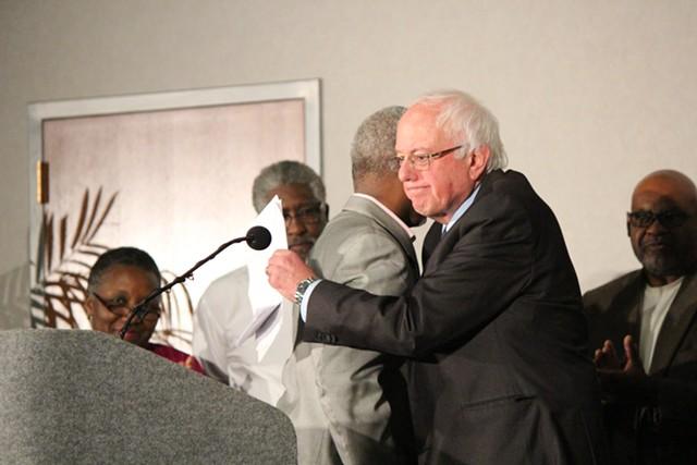 State Representative Terry Alexander embraces Sen. Bernie Sanders Saturday in Columbia - PAUL HEINTZ