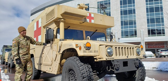 Vermont National Guard members arriving at University of Vermont Medical Center to set up tents - KEVIN MCCALLUM