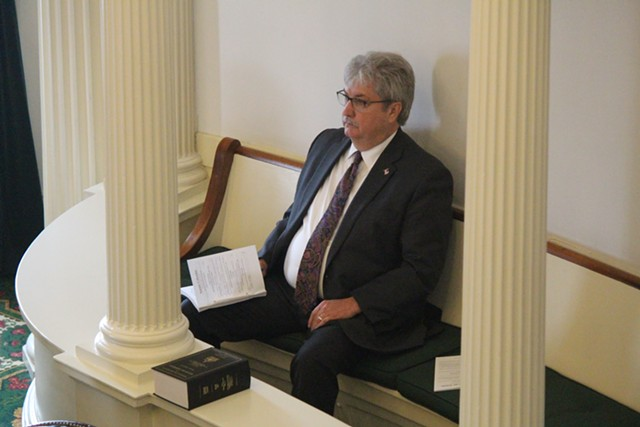 Sen. James McNeil socially distances himself Tuesday in the Vermont Senate chamber - PAUL HEINTZ