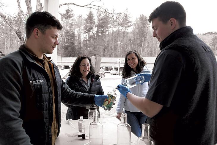 Mad River Distillers staff filling bottles for Neile Eisner and Anna Friedman - KEVIN MCCALLUM