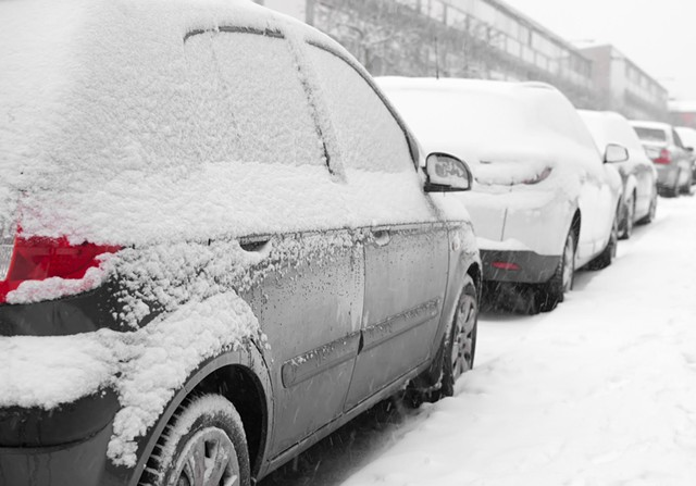 Winooski is considering a new approach to snowplowing and street parking. - DREAMSTIME