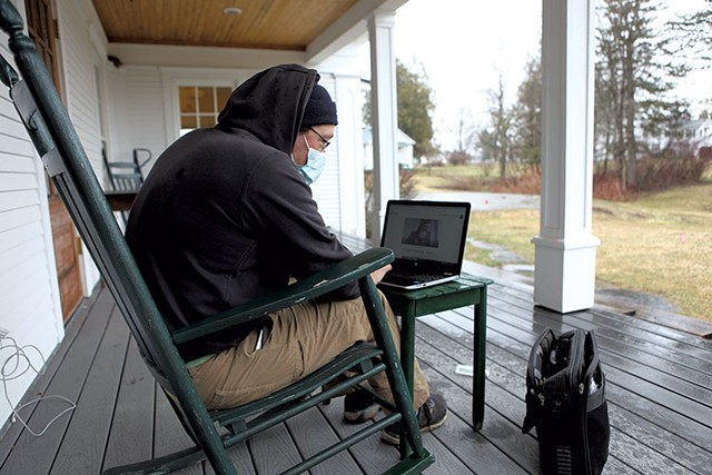 Mitch Hunt using the Wi-Fi outside of the Craftsbury library - KEVIN MCCALLUM