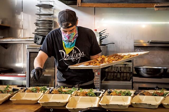 Andrew Ryan preparing meals at Drifters - LUKE AWTRY