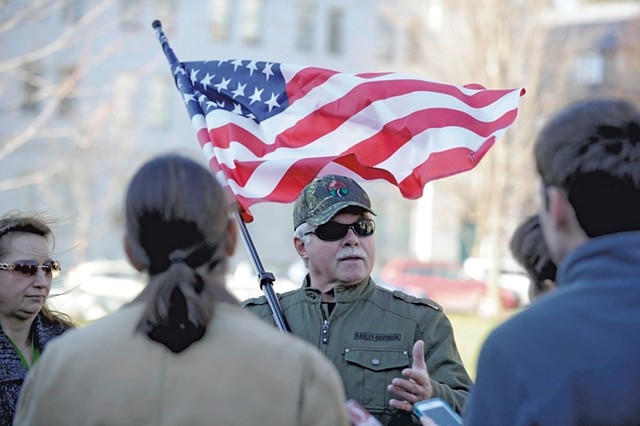 Rick Lawrence demonstrates against allowing Syrian refugees into Vermont - JEB WALLACE-BRODEUR