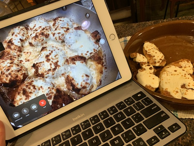 Broiled cheese-topped chicken thighs seen via FaceTime in Massachusetts and chicken breasts In Vermont - MELISSA PASANEN