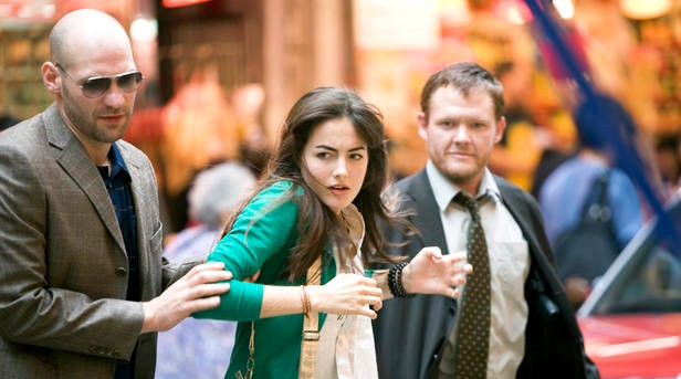 Ill-fated Division goons grab Kira on the streets of Hong Kong. - SUMMIT ENTERTAINMENT