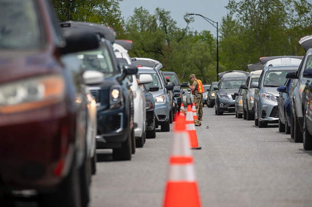 Cars lined up for food Tuesday on the Beltline in Burlington - JAMES BUCK
