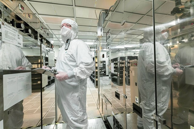 A GlobalFoundries employee working on the production floor in Essex Junction - COURTESY OF GLOBALFOUNDRIES