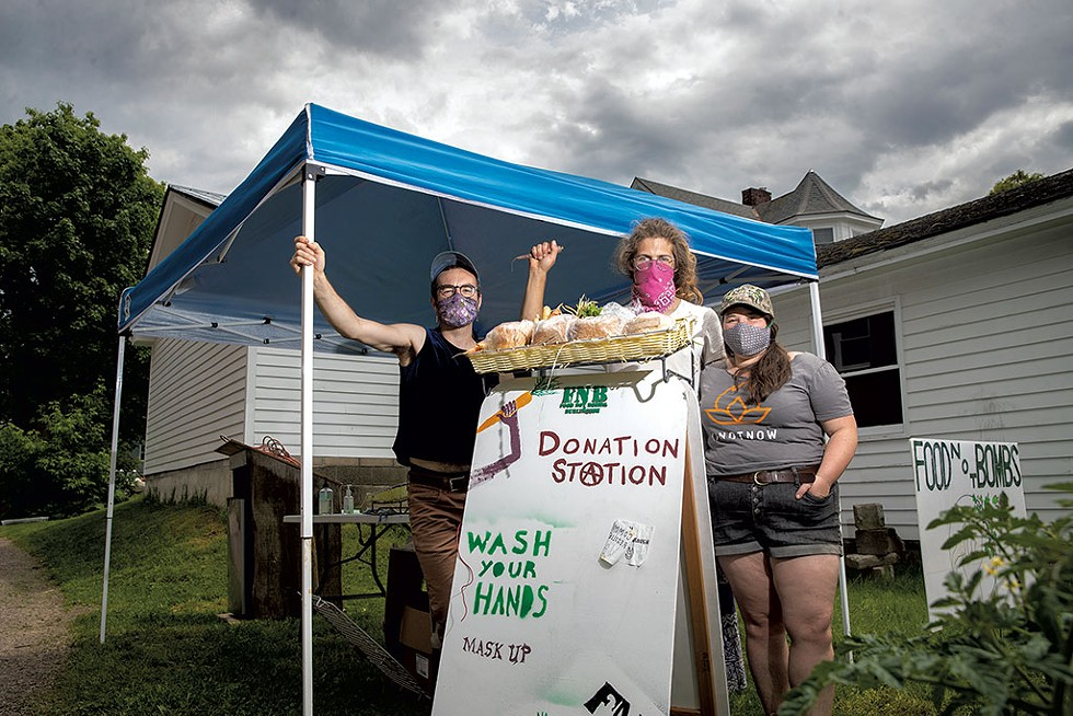 From left: Austin Kahn, Sam Bliss and Emma Schoenberg of Food Not Bombs - JAMES BUCK