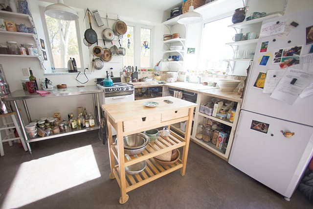 The kitchen has open shelving and a multipurpose island. - JAMES BUCK