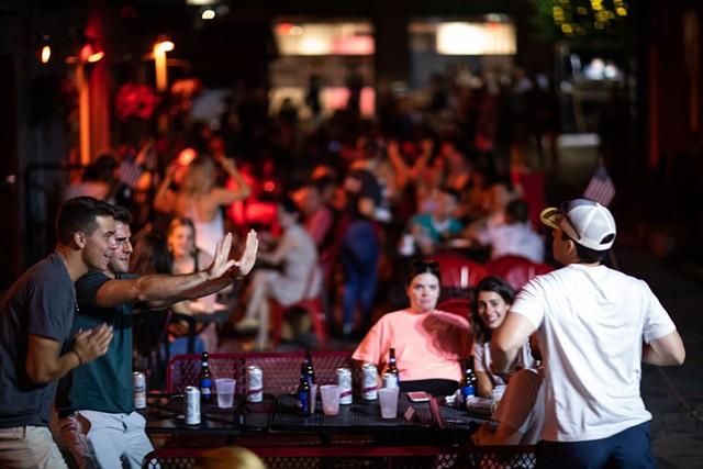 Revelers at Red Square in Burlington last Friday - LUKE AWTRY