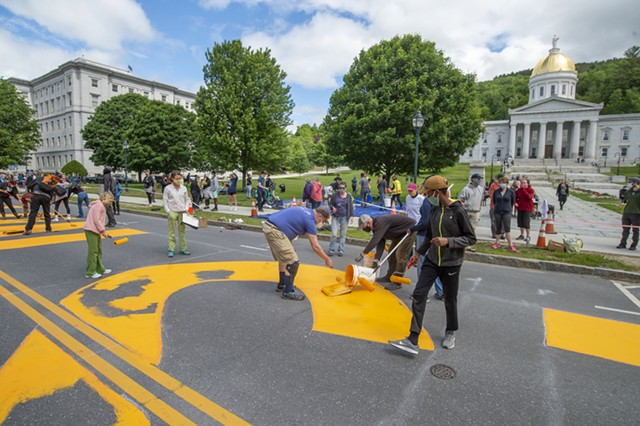 """Volunteers painting """"Black Lives Matter"""" in Montpelier last month - FILE: JEB WALLACE-BRODEUR"""
