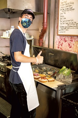 Red Onion Café Zachary James making sandwiches at Red Onion Café - LUKE AWTRY ©️ SEVEN DAYS