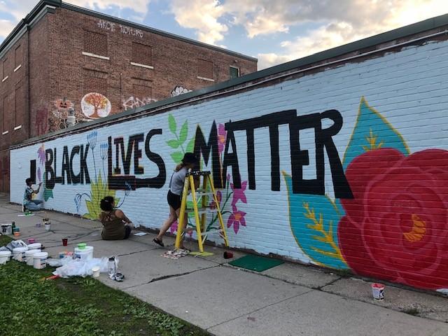 Arts So Wonderful muralists at work in downtown Burlington - COURTESY OF JAMIE BEDARD