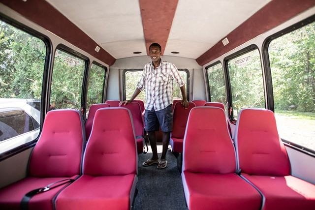 "Tinotenda ""Tino"" Charles Rutanhira and his tour bus - LUKE AWTRY"