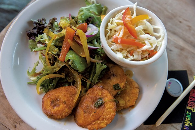 Bannan peze ak Fifi's Pikliz: fried green bananas with a spicy, pickled cabbage slaw - JAMES BUCK